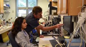 Dr. Joe Thompson and his intern Rashi Anand conducting an experiment on squid muscles at the Darling Marine Center in Walpole. Photo by Aliya Uteuova.