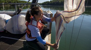 picture of student on research vessel
