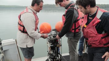 Boss instructs students using oceanographic equipment aboard the research vessel. Photo courtesy of Michael Starobin.